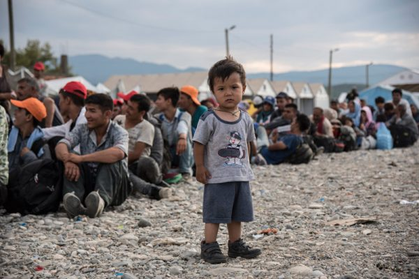 boy-standing-in-refugee-camp
