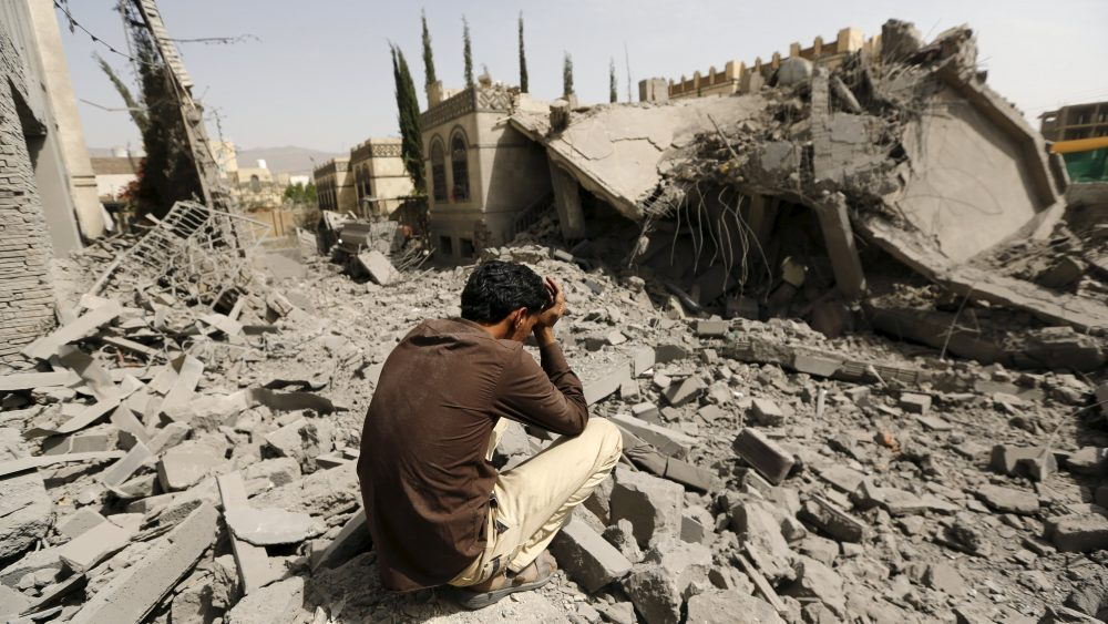 A guard sits on the rubble of the house of Brigadier Fouad al-Emad, an army commander loyal to the Houthis, after air strikes destroyed it in Sanaa, Yemen June 15, 2015. Warplanes from a Saudi-led coalition bombarded Yemen's Houthi-controlled capital Sanaa overnight as the country's warring factions prepared for talks expected to start in Geneva on Monday. REUTERS/Khaled Abdullah      TPX IMAGES OF THE DAY