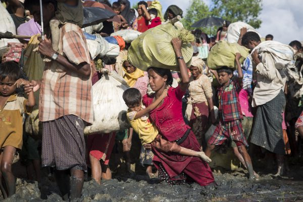 Thousands of new Rohingya refugee arrivals cross the border near Anzuman Para village, Palong Khali, Bangladesh. ; As an estimated 500,000 Rohingya sought safety in Bangladesh between late-August and October 2017, UNHCR worked with the authorities to create a transit centre to prepare for a further influx, as some 11,000 people crossed the border on 9th October. They crossed by land into south-eastern Bangladesh through several points. Many came from the Buthidaung area in Myanmar's northern Rakhine state. Some said they fled torching and killings. Others said they left in fear ahead of anticipated violence. To reach Bangladesh, they walked for days, many carrying children. They waded through marshland before swimming across the Naf river that divides the two countries. UNHCR worked swiftly to accommodate as many as possible in the camps and settlements in Kutupalong and Balukhali, and provided emergency relief items.