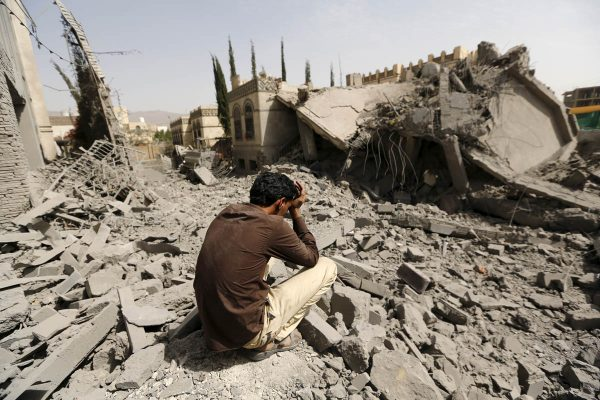 A guard sits on the rubble of the house of Brigadier Fouad al-Emad, an army commander loyal to the Houthis, after air strikes destroyed it in Sanaa, Yemen June 15, 2015. Warplanes from a Saudi-led coalition bombarded Yemen's Houthi-controlled capital Sanaa overnight as the country's warring factions prepared for talks expected to start in Geneva on Monday. REUTERS/Khaled Abdullah      TPX IMAGES OF THE DAY      - GF10000128032